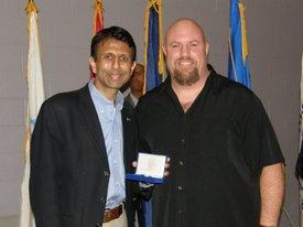 Receiving the Louisiana Veterans Honor Medal from Gov. Bobby Jindal